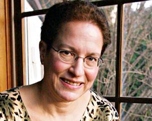 Shelley Frisch sitting by a window