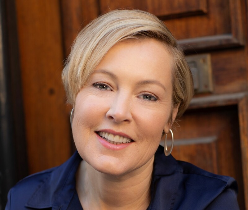 Gillian Tett, a women with short blond hair, smiling